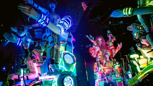 Dancers perform on large scale female robots during a show at The Robot Restaurant in Tokyo, Japan.