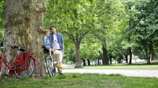 Green space: Cyclists take a break at a park in Berlin.