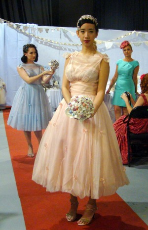 Models wear 1950s bridesmaids' dresses at the Love Vintage Fair.