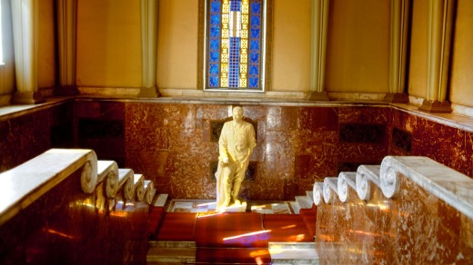 Reverence: Stalin's statue under a stained glass window.