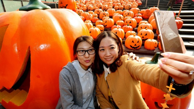 Visitors take selfies in an installation of 500 pumpkin lights to mark the Halloween in Shenyang, Liaoning province, China.