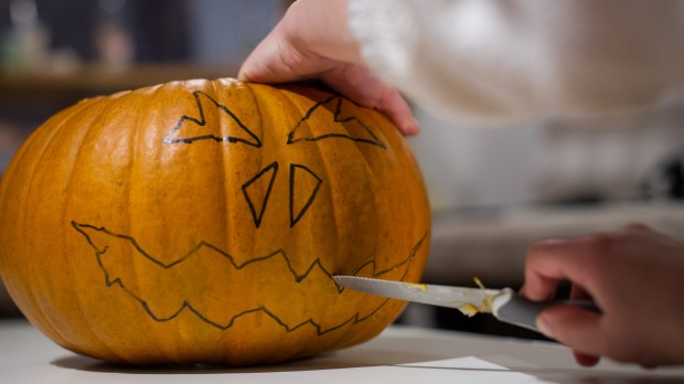 A grimacing face is carved into pumpkin in Hanover, Germany.