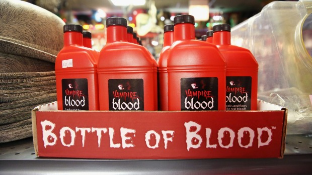 Bottles of fake blood for Halloween costumes are offered for sale at Fantasy Costumes in Chicago, Illinois.