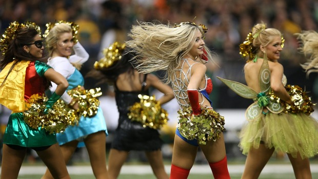 The Saintsations cheer dressed up in Halloween costumes during halftime during the Green Bay Packers v New Orleans ...