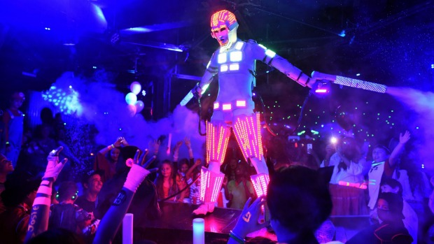 Kids in Halloween costumes join an electronic dance music party organised by CirKiz at a night club in New York, USA.