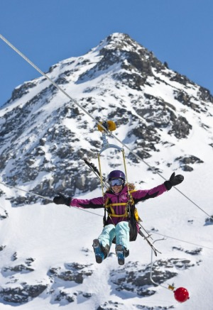 Cool experience: A teen rides the world's highest zip-line at Val Thorens, France.