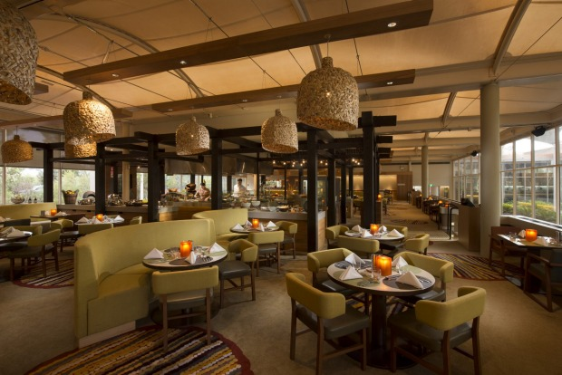 Outdoor views: The dining room in Sails in the Desert lets visitors see the landscape around the hotel.