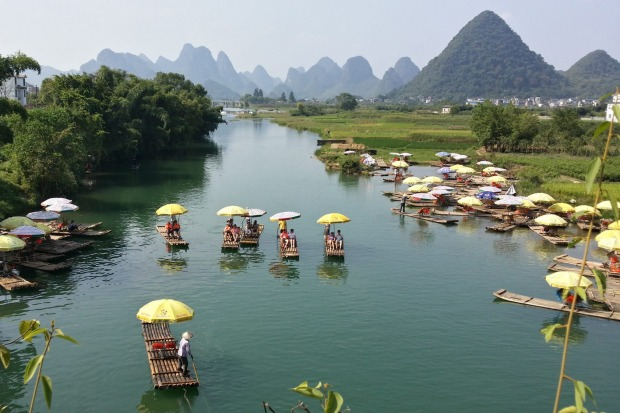 View from the 600-year-old stone Dragon Bridge that crosses the Yulong River, a little south of Yangshuo.