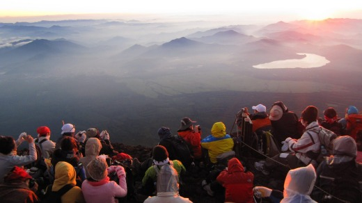 Fuji's summit: Satisfied pilgrim reach their goal.