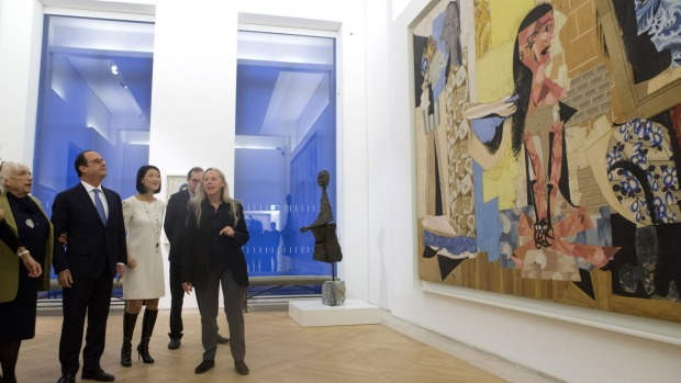 Maya Picasso, left, the daughter of Spanish artist Pablo Picasso, French President Francois Hollande, listen as chief ...