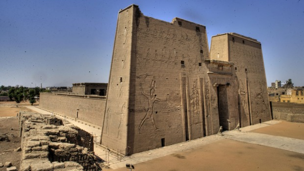 Edfu, Egypt: North of Luxor, cruise ships arrive at two barrages across the Nile. You pass through locks as donkey carts ...