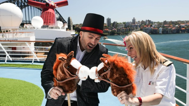 Cruise Director Eli and Senior Maitre'd Dessi compare horses on board Carnival Spirit.