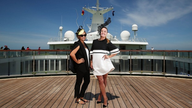 Fashion on deck: Aroha Moyler and Jamie Lee Werner pose with hats they made on Pacific Pearl.