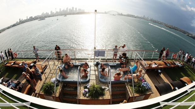 Passengers relax at Oasis on Pacific Pearl as it leaves Sydney.