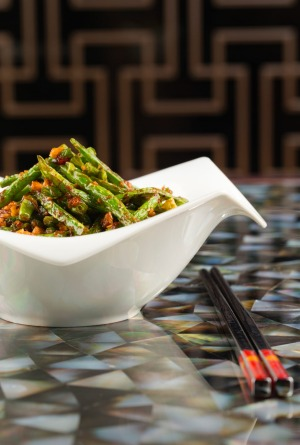 A Szechuan style sauteed string beans with minced chicken dished served at the Yuan.