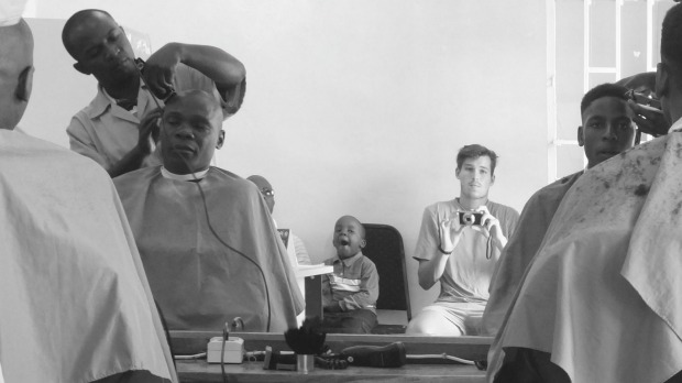 The image attached was taken in a barber'€™s shop in Lubumbashi, in the east of the Democratic Republic of Congo in ...