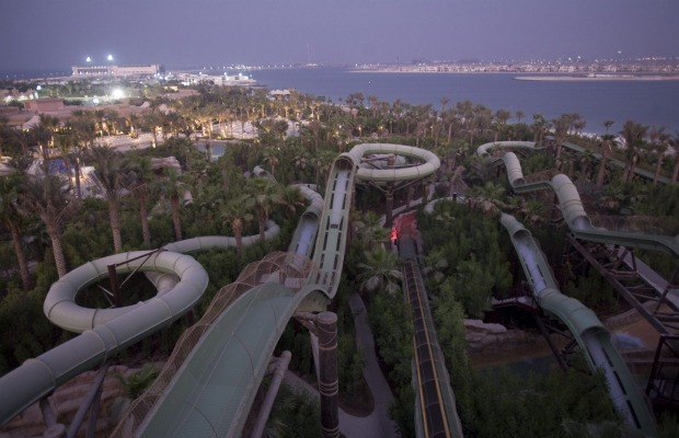 "The waterscape features water slides with names such as ""Leap of Faith"", including two which catapult riders through ..."