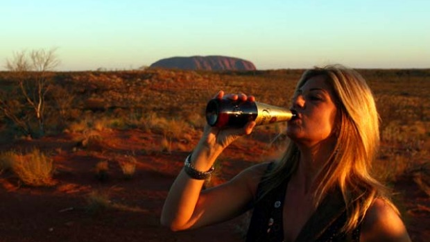 After paying all the extra expenses and adhering to the rules and regulations at Uluru, perhaps tourists feel a sense of ...