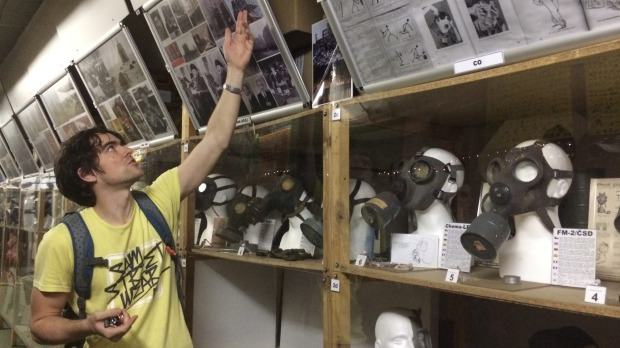 The way it was: Tour guide Ondra explains photographs, in Prague underground nuclear bunker. Photo: Ross Peake