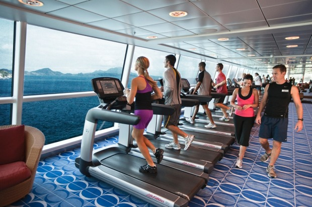 The fitness centre with ocean views on board the Celebrity Solstice.
