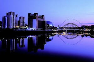 Newcastle by night: The redeveloped Tyne River waterfront and Gateshead Millennium Bridge.