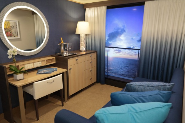 Interior rooms feature 'virtual balconies' displaying real-time views from outside the ship.