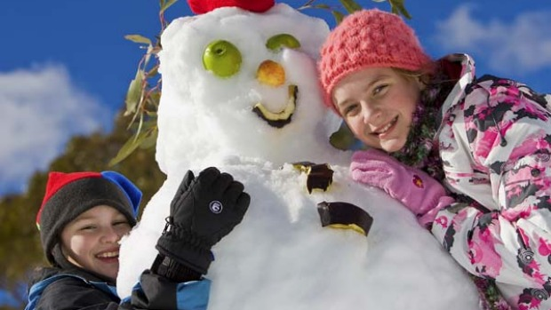 Cool fun ... children finesse their snowman.