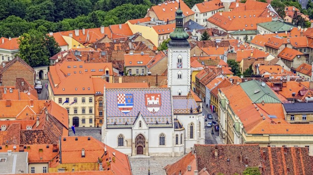 Landmarks: The Church of St Mark and Parliament building in Zagreb, Croatia.
