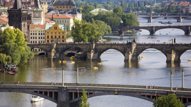 Charles Bridge on Vltava River in Prague: Its 16 arches, shielded wisely by ice guards, is decorated with 30 ...