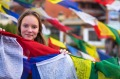 Cultural encounter: A teenager with Buddhist prayer flags in Nepal.