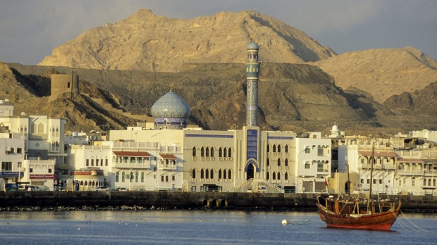 An Arab dhow, Shia mosque and traditional waterfront architecture in Muscat, Oman.