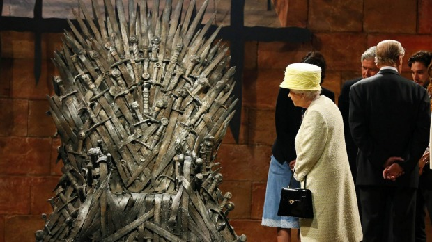 Ireland: Queen Elizabeth looks at the Iron Throne as she meets members of the cast on the set of the television series ...