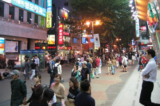 A night time street scene in the Korean capital of Seoul.