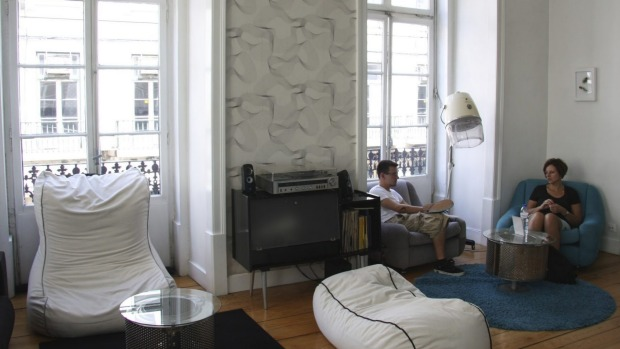 Guests in the first floor living room (note the turntable, hairdryer lamp and bean bags)