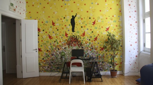 Colourful, subversive murals hint at the hostel's creative roots
