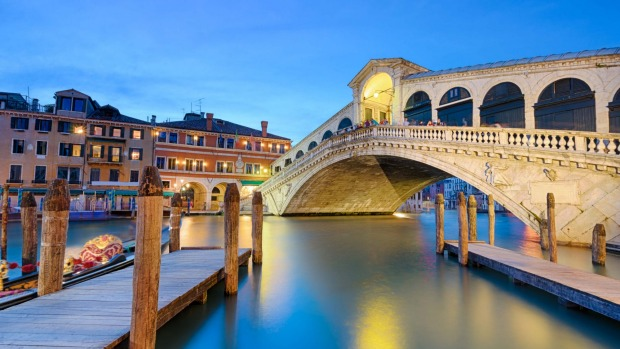 Rialto Bridge, Venice, Italy: It's most famous of the four bridges which cross Venice's Grand Canal.