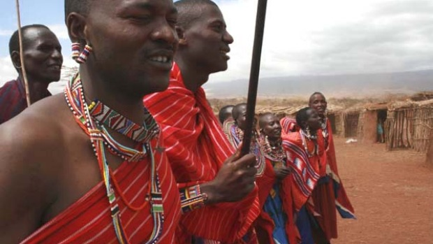 Local attractions ... a chief leads his village in welcoming guests.