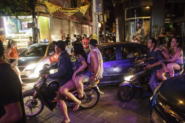 You don't need to wear a helmet, but you'd be mad not to: Lots of tourists hire motorbikes and drive around without ...