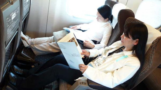 Quiet ride ... Japanese passengers sit silently on board.