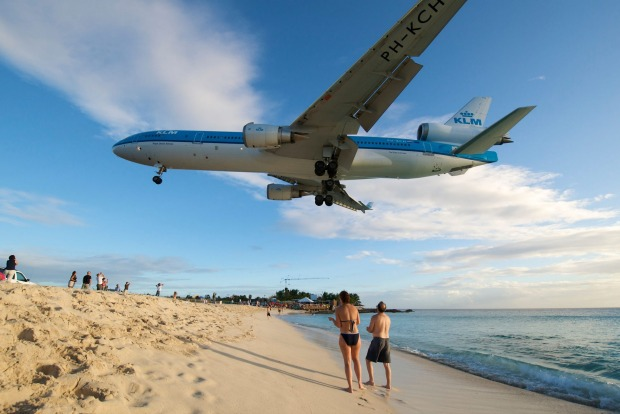 A planespotter's dream: Aircraft land at Princess Juliana International Airport just metres above the heads of ...