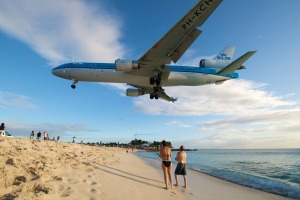Sint Maarten a plane flies low over Maho Beach into the airport.