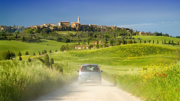 Spend a night in a Tuscany villa and absorb the beauty: A winding road leading to the town of Pienza in Tuscany.