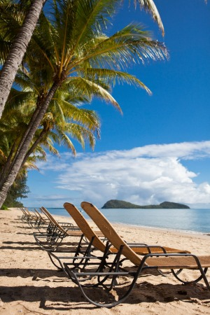Sun lounges on the beach at Palm Cove, Cairns, Queensland, Australia.