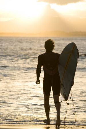 Heading out for a sunset surf at The Pass, Byron Bay.