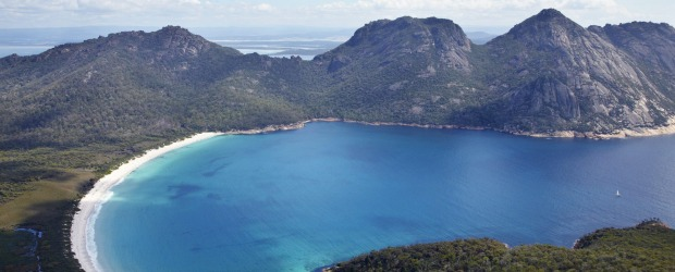 Impossible to top: Wineglass Bay in Freycinet National Park, Tasmania, with the Hazards mountain chain huddled behind it.