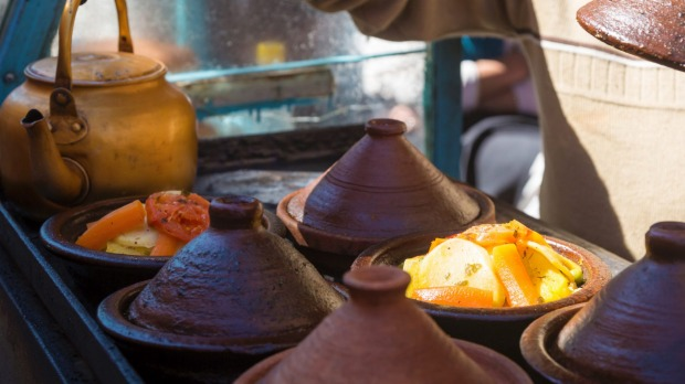 Moroccan tajines: conical-lidded pots filled with chicken and preserved lemon, or meatballs and eggs, swimming in tasty ...