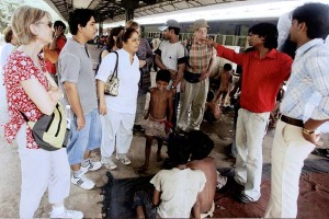 Hard knocks ... a trust guide looks on as a former street child (second from right) tells his story at the New Delhi ...