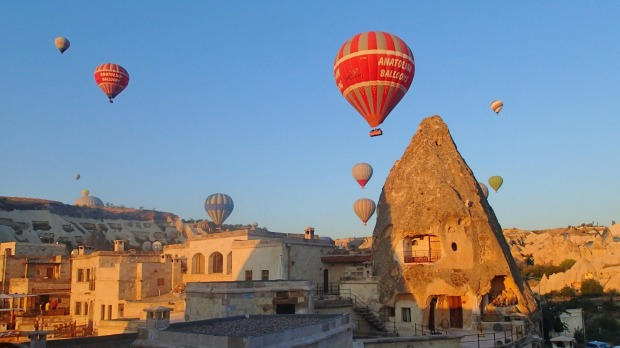 This photo was taken at dawn from our hotel balcony in Goreme, Turkey in  August 2014.  We were given a cup of coffee, ...