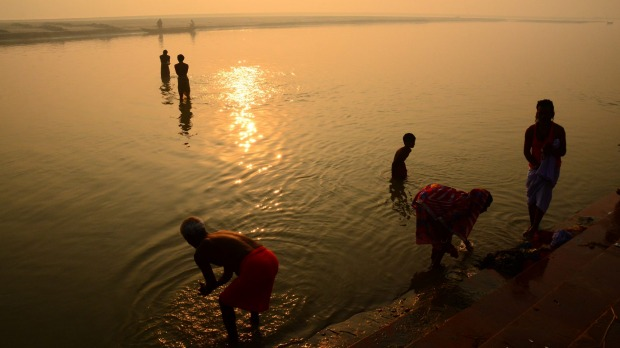 Sunrise by the river at Sonepur in India, during an elephant fair.  Although this photo evokes a sense of peace and ...