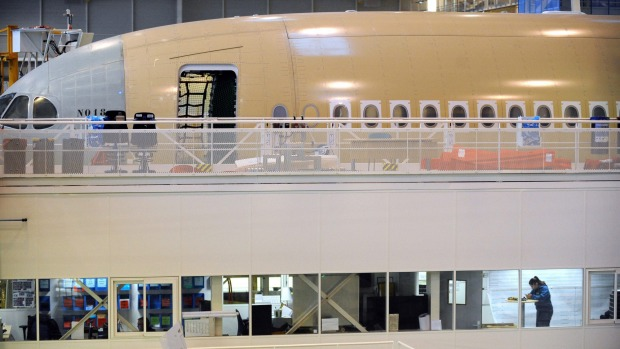Technicians work on the assembly line of an Airbus A350 at the Airbus headquarters in Toulouse.